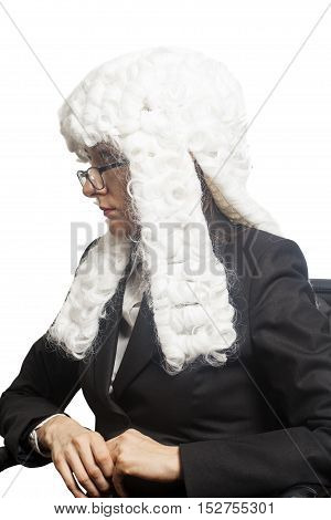 Female judge wearing a wig with eyeglasses isolated on white