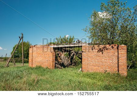 The Ruined Brick Building In The Exclusion Rural Area After Chernobyl Catastrophe. The Consequences Of The Nuclear Pollution