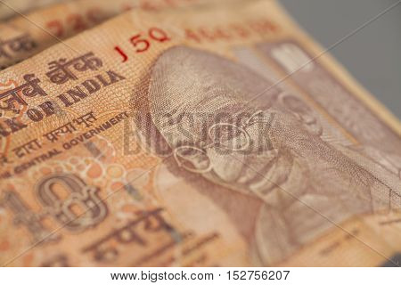 Ten Indian rupees isolated on gray background