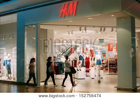Vilnius, Lithuania - July 08, 2016: Buyers, Three Women Entering To H M Store For Shopping In Acropolis Shopping Mall.