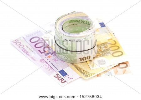 Euro banknotes under rubber band on banknotes isolated
