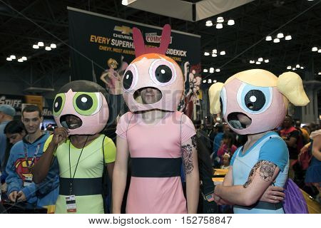 NEW YORK NEW YORK - OCTOBER 9: Guys wear Power Puff Girl costumes at NY Comic Con at Jacob K. Javits convention center. Taken October 9 2016 in New York.