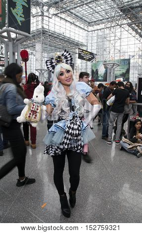 NEW YORK NEW YORK - OCTOBER 9: Woman wearing Alice in Wonderland costume at NY Comic Con at Jacob K. Javits convention center. Taken October 9 2016 in New York.