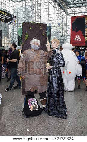 NEW YORK NEW YORK - OCTOBER 9: Couple wearing costumes at NY Comic Con at Jacob K. Javits convention center. Taken October 9 2016 in New York.