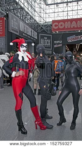 NEW YORK NEW YORK - OCTOBER 9: Person wearing Harley Quinn costume with others at NY Comic Con at Jacob K. Javits convention center. Taken October 9 2016 in New York.
