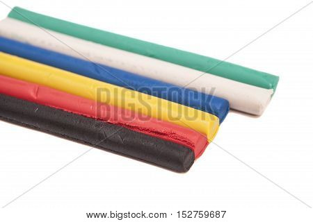 Colorful plasticine isolated on a white background