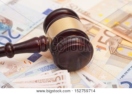 Judge gavel and euro banknotes money background