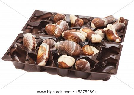 Gourmet chocolate as shell sweet praline bonbons background.