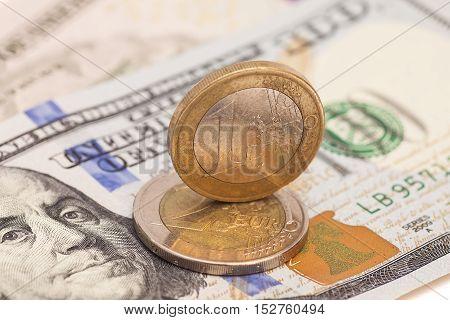 Euro coins over dollar US money notes