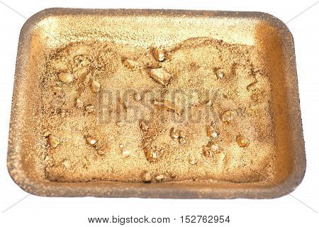 Golden nuggets on grungy wash pan with sand isolated