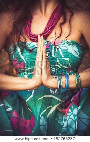 woman practice yoga outdoor closeup of hands in namaste gesture