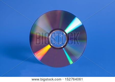 Compact shiny disk isolated on blue background