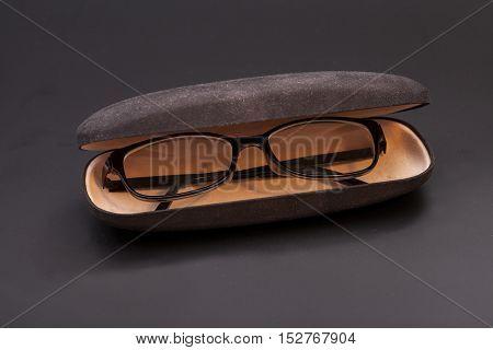 Eyeglasses and eyeglasses case in a black background