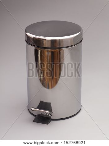 Garbage bin isolated on a gray background