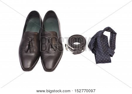 black necktie black men's shoes and leather belt