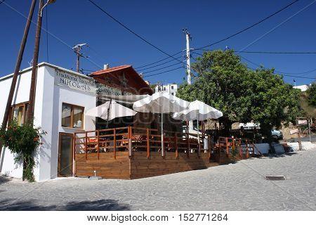 ASKLIPIO, RHODES, GREECE - JUNE 2012: Traditional Greek tavern at Asklipio town in eastern part of Rhodes island
