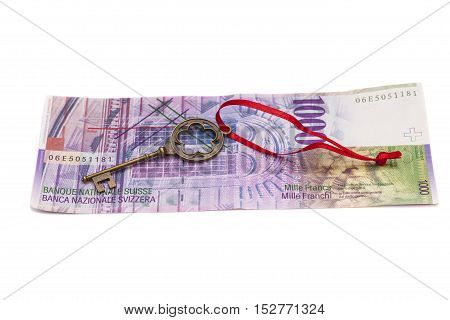 Key To Success With Red Bow on Swiss 1000 Francs isolated on white