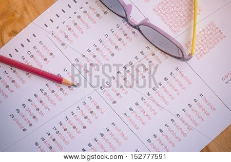 exam paper answer sheet test score sheet with pencil : education concept