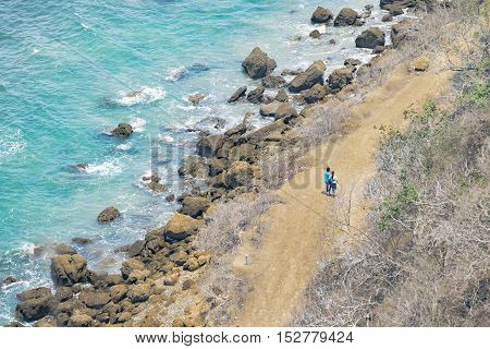 Couple Walking At Road In Rocky Coastiline Santa Elena Ecuador