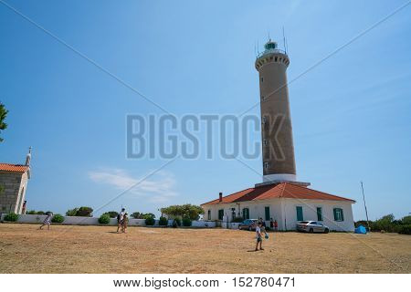 Dugi Island, Croatia - July 20, 2016: The lighthouse of Veli Rat on the island Dugi Otok in the Adriatic sea of Croatia