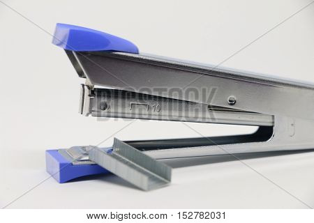 Stapler on the white background. Miscellaneous of office equipment. Paper clip,Stapler,office tool