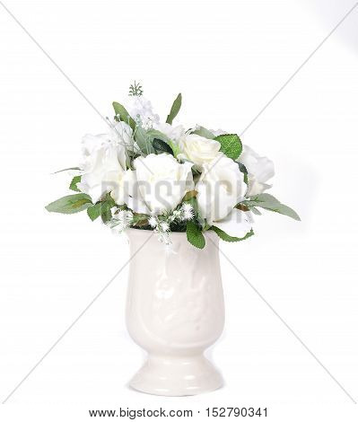 Plastic flower in vase isolated on white  background.