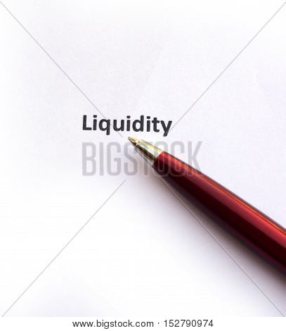 Liquidity with pen isolated on white background.