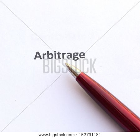 Arbitrage with pen isolated on white background.
