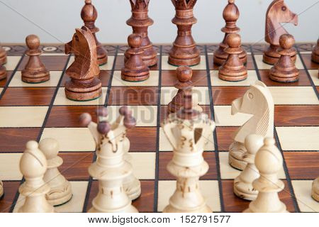 A woden chess pieces on the chessboard