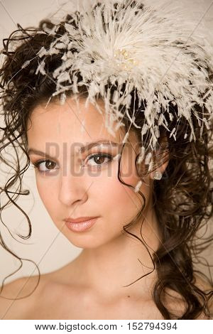 Beautiful tender bride with feather hairpin in her hair