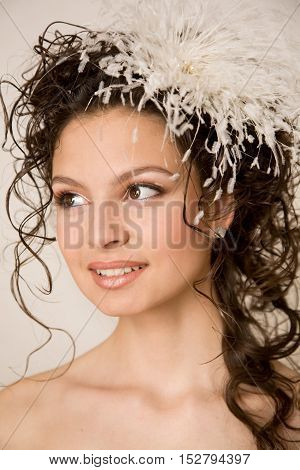 Stylish modern bride with feather hairpin in her hair