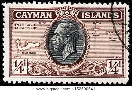 LUGA RUSSIA - JUNE 25 2016: A stamp printed by CAYMAN ISLANDS shows portrait of King George V against Cayman Islands map - British Overseas Territory in western Caribbean Sea circa 1935