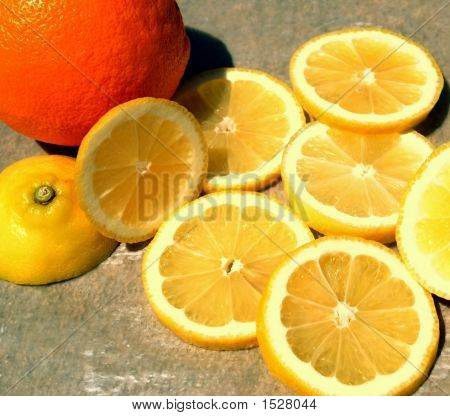 Lemon Slices And An Orange