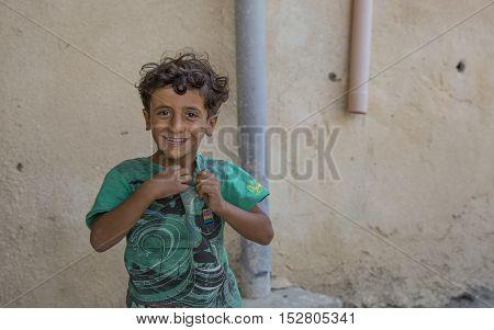 Wakan village Oman October 15th 2016: omani boy smiling