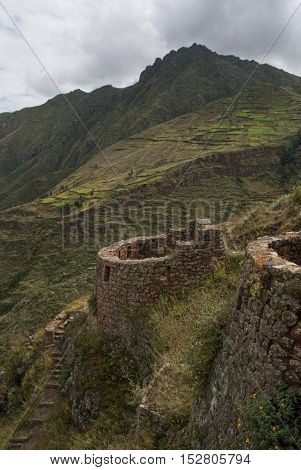 Inca ruin old watchtower in andes landscape, Urubamba valley