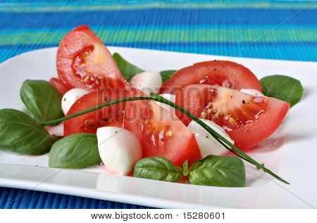 Fresh tomato salad with basil and bocconcini cheese.