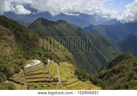 Ancient Inca ruin Phuyupatamarca bathing in the sun, Inca Trail, Peru