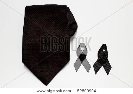 Black ribbon and black necktie; decoration black ribbon hand made artistic design for sadness expression isolated on white background.