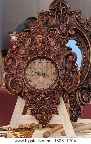 Floral woodwork analogue antique clock. Wooden frame