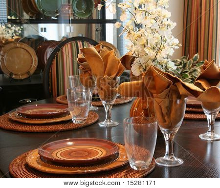 Dining room table elegantly set for Thanksgiving.