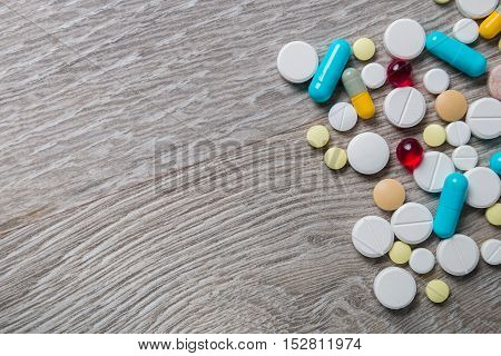 Lot Of Colorful Medication And Pills From Above On Grey Wooden Background. Copy Space. Top View, Fra