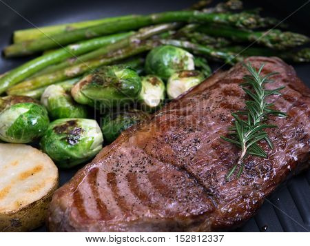 close up view of nice fresh steak with vegetables