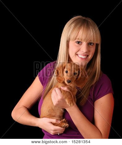 Beautiful blond girl and her look-alike blond puppy. poster