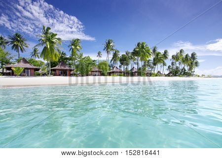 view of nice exotic huts on tropical beach