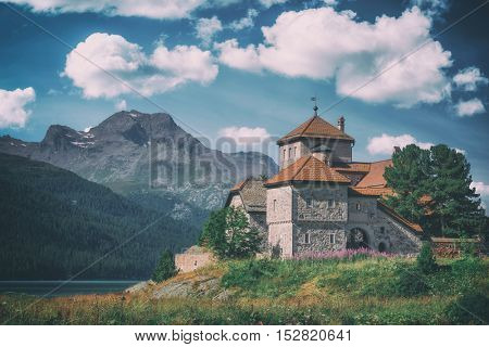 Amazing sunny day at Champferersee lake in the Swiss Alps. Castle of Crap da Sass, Silvaplana village, Switzerland, Europe, toned like Instagram filter