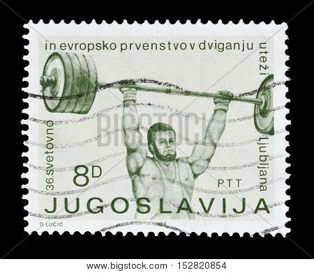YUGOSLAVIA - CIRCA 1972 : Cancelled postage stamp printed by Yugoslavia, that shows Weight lifting.