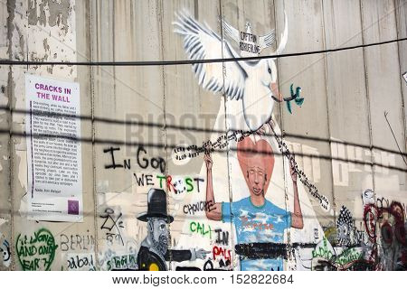 BETHLEHEM, PALESTINE - OCTOBER 7, 2016:  Detail of graffiti on the separation barrier between Palestine and Israel. Palestine - 2016
