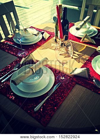 Red sparkling  fine dinning table setting for four