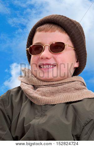 Boy in Winter Clothing Enjoying the Sunshine