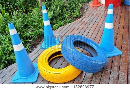 Automotive Safety Concepts Two Painted Tires with Blue and White Traffic Cones.